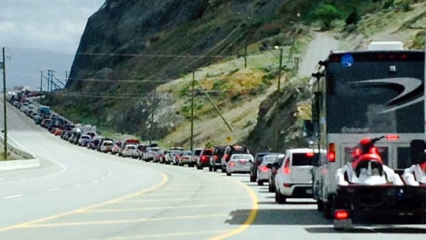 This photo taken by our reporter at the scene shows the extent of the traffic tie-up which curves around the corner of the bluffs.