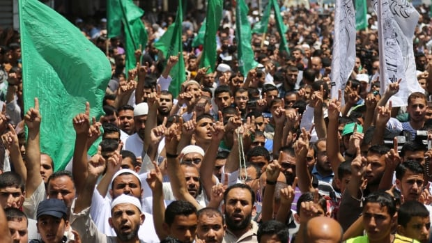 Palestinian Hamas supporters chant islamic slogans during a demonstration against the Israeli military operations in the West Bank in Jebaliya refugee camp, northern Gaza Strip, on Friday.