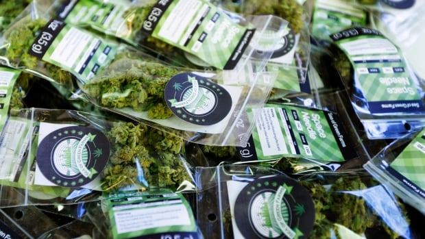 "Packets of a variety of recreational marijuana named ""Space Needle"" are shown during packaging operations at Sea of Green Farms in Seattle."