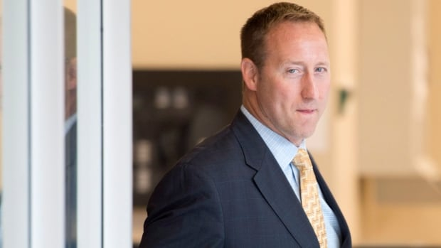 Federal Justice Minister Peter MacKay arrives at a Commons justice committee meeting regarding the government's prostitution bill on Monday.