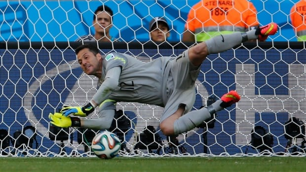 Julio Cesar of Brazil makes a stop during his team's shootout against Chile in the FIFA World Cup Round of 16. The pressure is all on the penalty taker, says former Canadian keeper Craig Forrest.