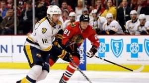 Nashville's Mike Fisher, left, controls the puck in a game in Chicago in March.