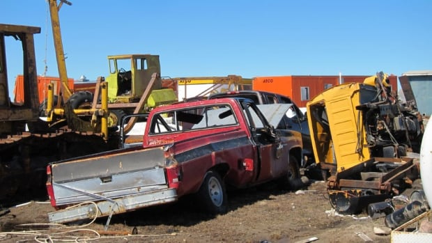 Scrap metal piles up in Gjoa Haven, Nunavut. The Northern End-of-Life Vehicle Recycling Program by Summerhill Impact (formerly the Clean Air Foundation) is in its pilot year and aims to ship about 250 old vehicles to the south by the end of September.