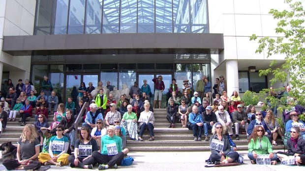 The Yukon chapter of the Canadian Parks and Wilderness Society holds a silent vigil outside the courthouse on the opening day of the trial over land use planning in the Peel watershed, a wilderness the size of Nova Scotia. Inside, the courtroom inside was packed with spectators from First Nations groups, environmental organizations, the mining industry and the general public.