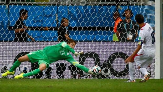 Goalkeeper Tim Krul of the Netherlands saves a shot by Costa Rica's Bryan Ruiz during a penalty shootout in their 2014 World Cup quarter-finals at the Fonte Nova arena in Salvador, Brazil. Krul, a last-minute substitute, has been hailed for his heroics and criticized for talking to Costa Rica's kick-takers before they shot.