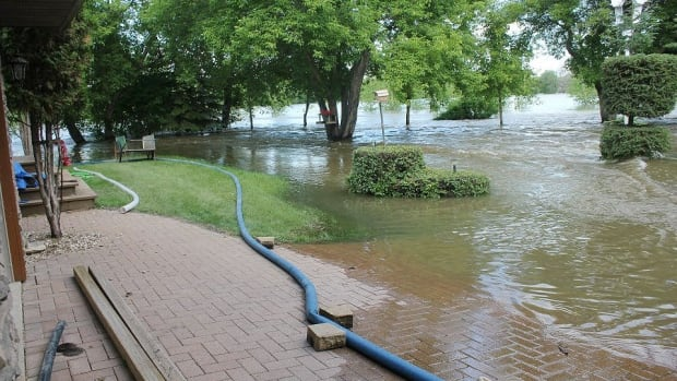 Water surrounded many homes in the community of St. Lazare earlier this month. The province said Thursday it has accepted 300 applications for disaster financial assistance from about 270 Manitobans affected by flooding.