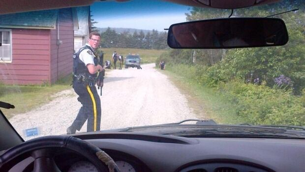 This image, taken by Helen Norve's father, shows RCMP officers on Little Tancook Island.