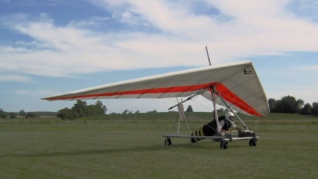 A file photo of Ken Kinzie on his hang glider. Kinzie broke the record for the farthest hang-glide flight in Ontario on Saturday.