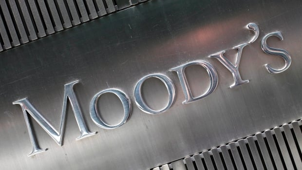 Moody's Investors Service lowered the outlook for Canada's banks to negative from stable in a report Tuesday, citing Ottawa's 'bail-in' law.