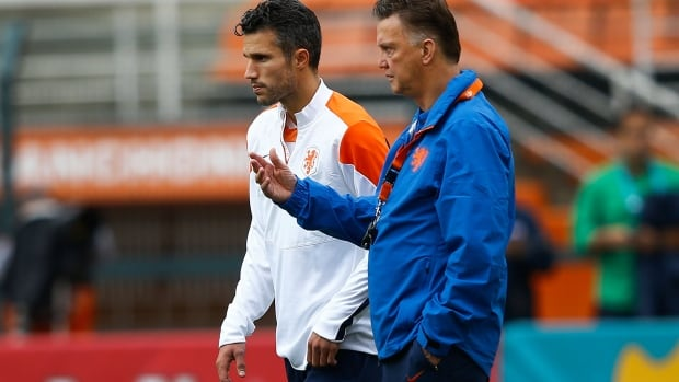 Dutch captain Robin van Persie and coach Louis van Gaal face a key decision ahead of Wednesday's World Cup semifinal. Van Persie has a stomach illness and may not be able to play.