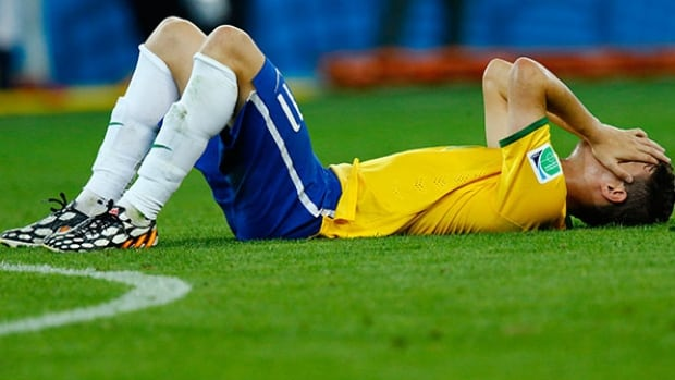 Brazil's Oscar reacts after his team's 7-1 dubbing at the hands of Germany in the World Cup semifinal on Tuesday.