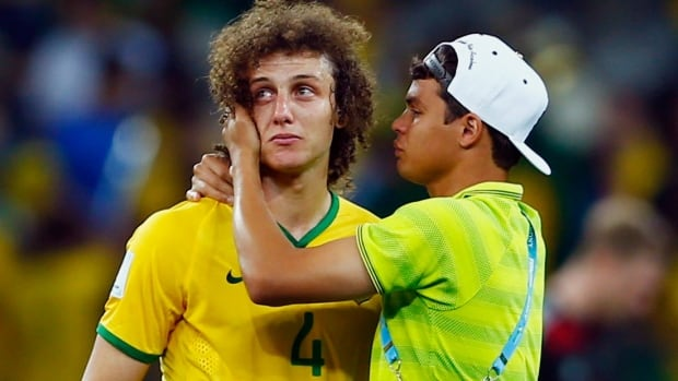 Brazil's David Luiz is consoled by the suspended Thiago Silva after their humiliating defeat to Germany in the FIFA World Cup semifinals.