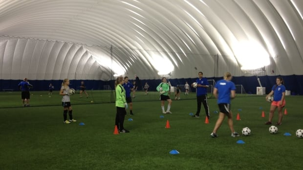 Girls from the North Shore Girls Soccer Club practice in The Bubble