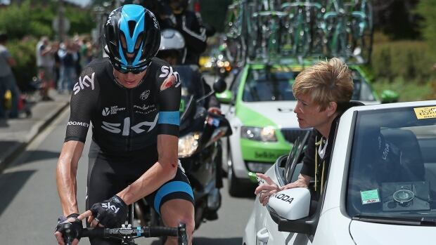 Chris Froome is seen here receiving medical attention after being involved in a crash  during stage four of the 2014 Le Tour de France from Le Touquet-Paris-Plage to Lille on Tuesday. Following a second crash, the defending champion has dropped out of the event.