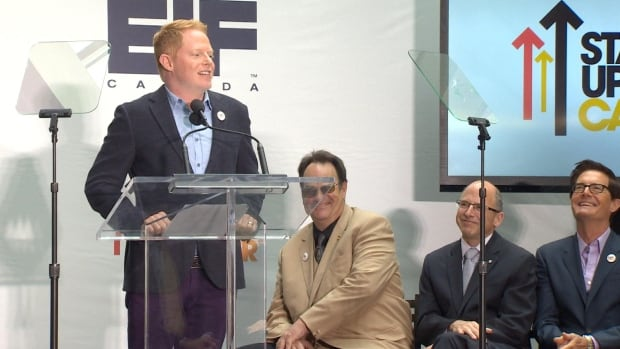 Actors Jesse Tyler Ferguson, Dan Aykroyd and unknown man and Kyle MacLachlan announce the upcoming Stand Up To Cancer broadcast at the MaRs building in Toronto, July 9, 2014.