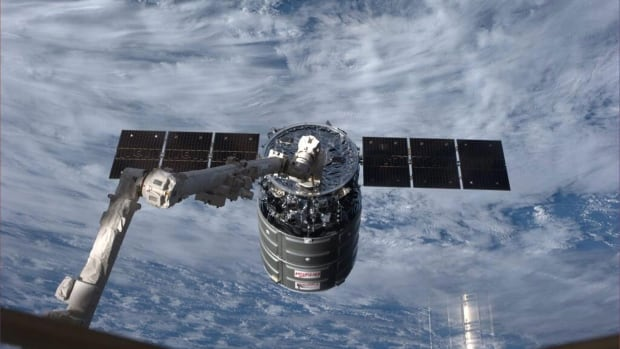 "The Cygnus spacecraft made its first official cargo delivery to the International Space Station in January. When a spacecraft arrives, it is pulled from a ""berthing box"" to a docking port by the space station's Canadarm2 robotic arm."