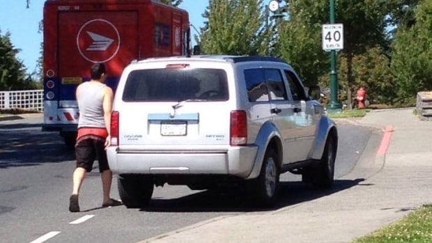 Matt Gadd, 39, posted this photo on Facebook, which he says shows the SUV and driver that hit him at the intersection of Island Highway at Helmcken Road in View Royal, B.C., on Tuesday afternoon.