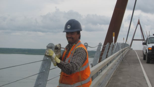 Crews are installing new guard rails on the Deh cho Bridge, bringing the height up to 1.6 metres. It's part of the final phase of work on the project, which should be complete this fall.