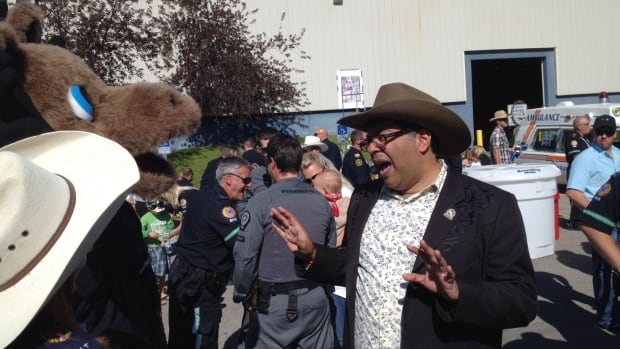 Naheed Nenshi meets the moose mascot - all in a day's work at the Stampede for Calgary's mayor.