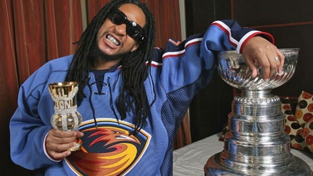 """Lil Jon is often photographed sipping from a """"crunk cup"""" — a goblet or cup adorned with sparkling accessories."""