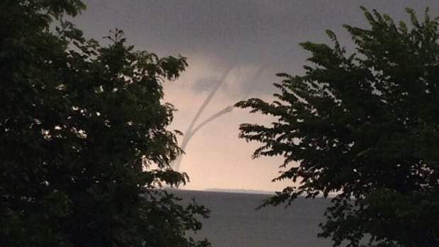 The Pelee Island Heritage Centre posted a picture of two twisting waterspouts over the water just before 6 a.m.