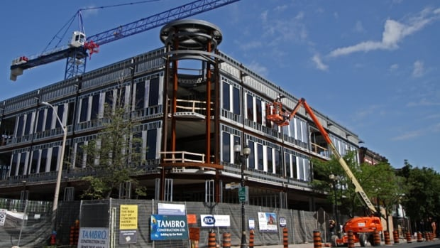 This July 2014 file photo shows crews working on the first major building construction project on James Street North in decades.