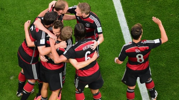 Germany players celebrate after Thomas Mueller scored his side's first goal during the World Cup semifinal soccer match between Brazil and Germany at the Mineirao Stadium in Belo Horizonte, Brazil, on July 8, 2014.