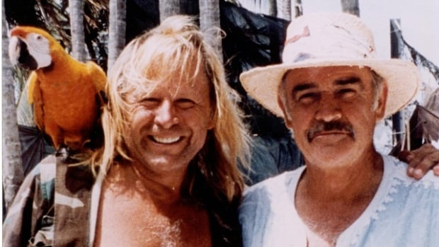 A statement from Peter Nygard includes a photograph that the Canadian fashion mogul says shows him, left, with actor Sean Connery, who is part of a group of celebrity landowners that is suing the Bahamian government over the Canadian fashion mogul's development activities.