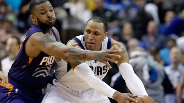 Mavericks forward Shawn Marion, right, keeps the ball from Suns forward P.J. Tucker, left, during an April 12 game in Dallas. Tucker was the top defender and acknowledged leader in Phoenix's surprising turnaround last season.