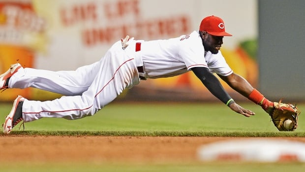 Reds second baseman Brandon Phillips torn ligaments in his left thumb on this play during Wednesday's 4-1 win over the Chicago Cubs. He is expected to be sidelined six weeks.