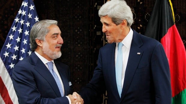 Afghan presidential candidate Abdullah Abdullah, left, shakes hands with U.S. Secretary of State John Kerry at the start of a meeting at the U.S. Embassy in Kabul on Friday.