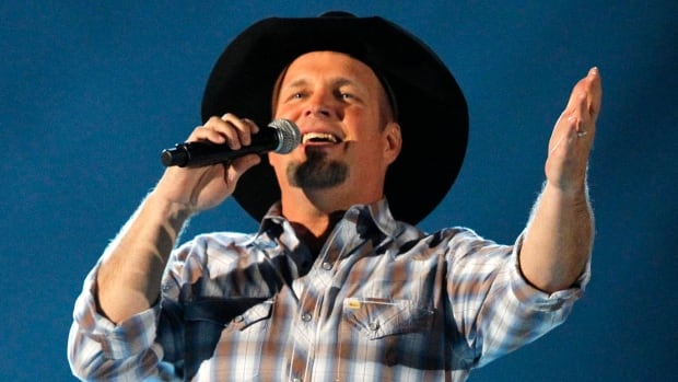 Garth Brooks says he'll release a highly-anticipated new album in late fall 2014. Details of his world tour will be announced on July 15.