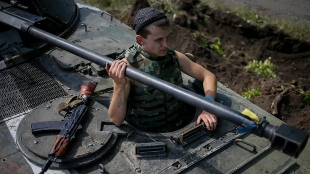 A Ukrainian soldier looks out from an armoured vehicle at a position near the eastern Ukrainian city of Konstantinovka. A Ukrainian Interior Ministry official said at least 30 servicemen were killed Friday after pro-Russia rebels fired on them with missiles.