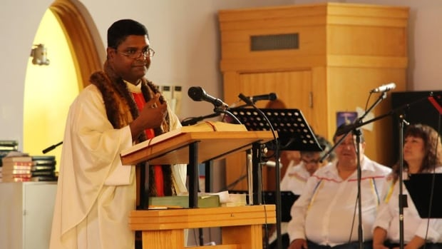 Father Paul Payyapilly delivers his final sermon in St. Joseph's cathedral in Fort Smith, N.W.T. July 7. Father Paul opened the church to aboriginal spirituality, but not everyone approved.
