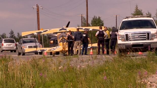 A small plane landed on Yellowknife's Deh Cho Boulevard near the airport just after noon on Friday.