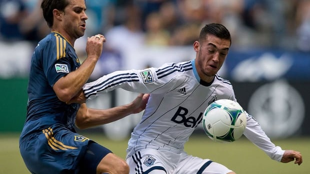 Whitecaps' Canadian midfielder Russell Teibert, right, has signed a multi-year contract with the MLS club. Teibert, who has played 53 MLS games, served as Vancouver's captain during their two Amway Canadian Championship matches in May.