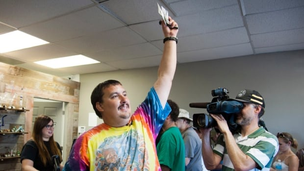 Mike Boyer became the first person to legally buy marijuana in Washington state this week, an honour he camped out to win.