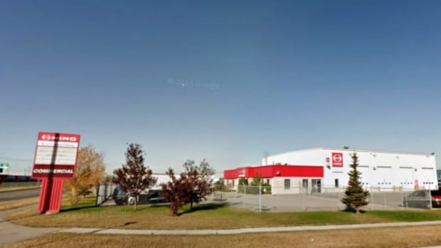 A man was found pinned under a vehicle at Hino Central Calgary in the southeast.