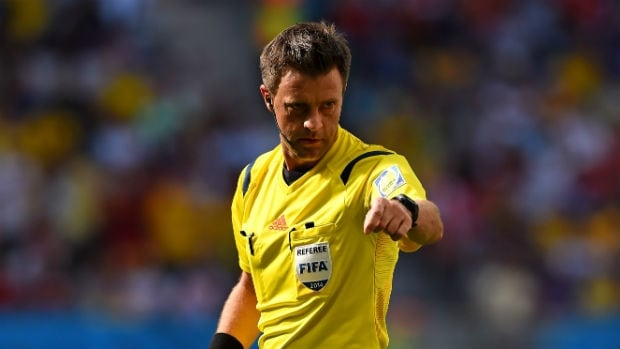 Referee Nicola Rizzoli gestures during the quarter-final between Argentina and Belgium at the 2014 FIFA World Cup in Brazil.