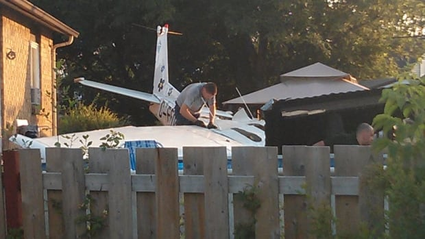 After crashing into this backyard the pilot, who was alone in the aircraft, was taken to hospital for the treatment of minor injuries.