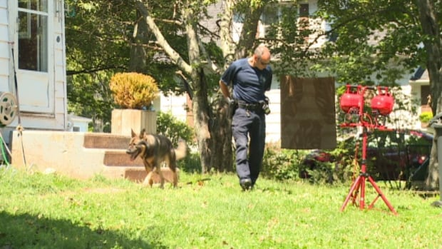 Police look for clues at a home in Charlottetown were a man died Friday night.
