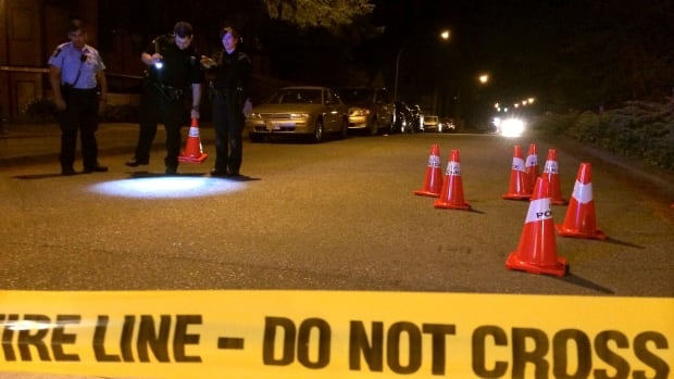 Police in Delta look for bullets and bullet casings after gunshots are reported near the intersection of Scott Road and Wade Road in the early hours of July 13, 2014.