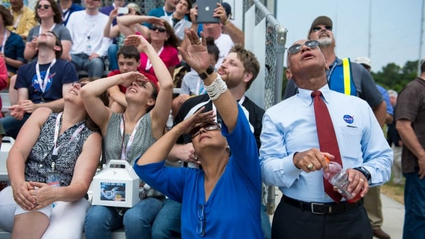 This image released by NASA shows administrator Charles Bolden, right, standing with his wife, Alexis Walker, and other guests as they watch the launch of the Orbital Sciences Corporation Antares rocket, with the Cygnus cargo spacecraft aboard, Sunday.