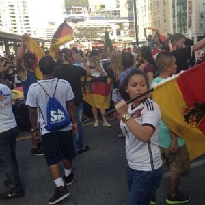 German flags waving at Yonge-Dundas Square