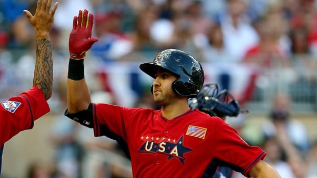 Joey Gallo, right, of the U.S. Team celebrates with J.P. Crawford after hitting a home run against the World Team during the All-Star Futures Game at Target Field in Minneapolis, Minn. Gallo's two-run blast paved the way for a 3-2 victory on Sunday.