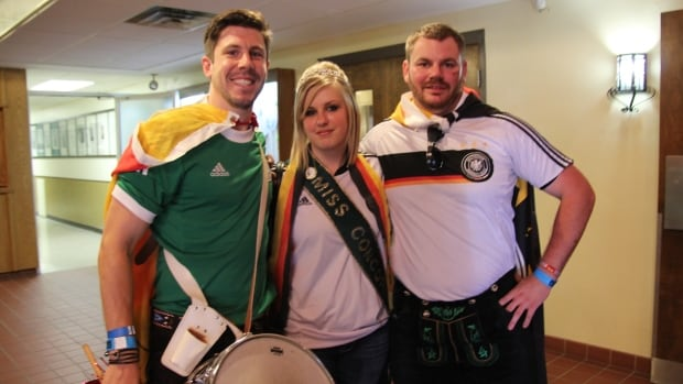 28-year-old Michael Schatz (left) was overcome with emotion when Germany scored. To his left is Miss Concordia Amanda Sokalan, 24, and Steve Richtaritsch, 29.