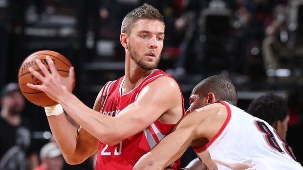 Small forward Chandler Parsons, left, is going to the Mavericks after Houston decided not to match the restricted free agent's three-year offer sheet worth more than $45 million US.
