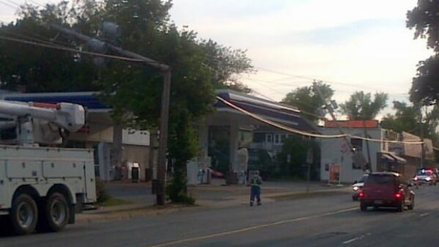 Three power poles were knocked down by a garbage truck Monday morning on Quinpool Road. Nova Scotia Power says seven to 12 customers remain without power, down from 1,200 at its peak.