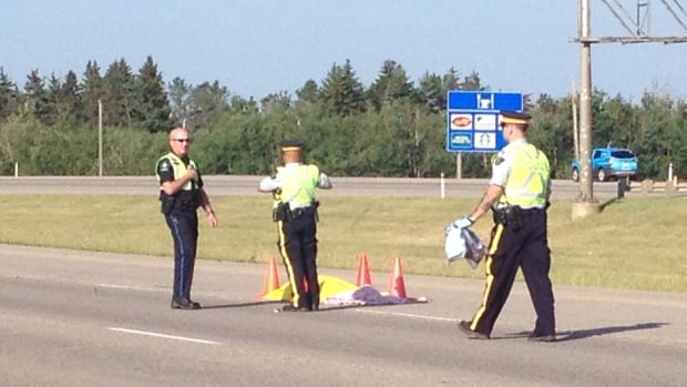 A man trying to walk across Highway 2 in Leduc was hit by a car Monday morning. He was declared dead at the scene.