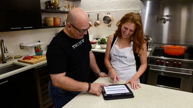 IBM's Steve Abrams (left) and Dawn Perry, senior food editor for the magazine Bon Appétit, test out Chef Watson in the Bon Appétit kitchen in New York City.